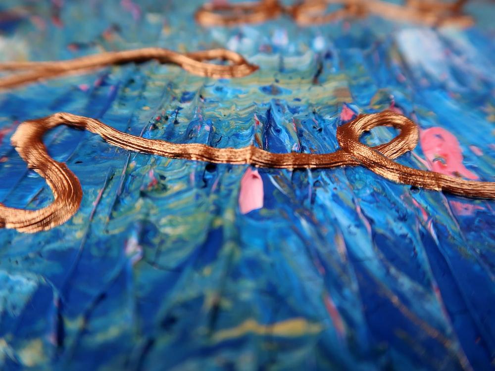 brown rope on blue water