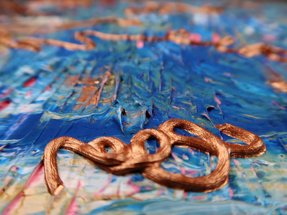 brown rope on blue water