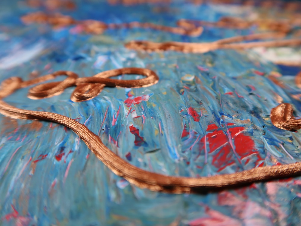 brown and black snake on blue and red water