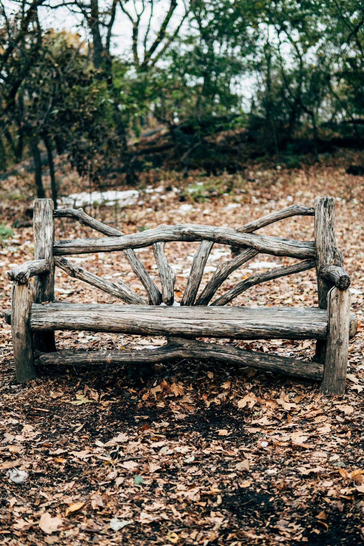 empty gray wooden park bench