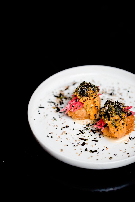 food on round white ceramic plate