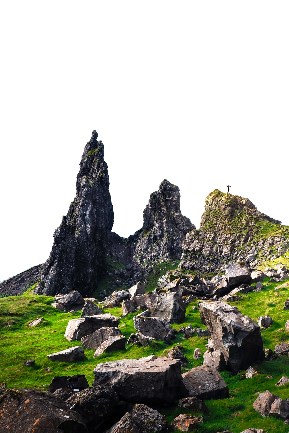 gray rock formations on green field during daytime