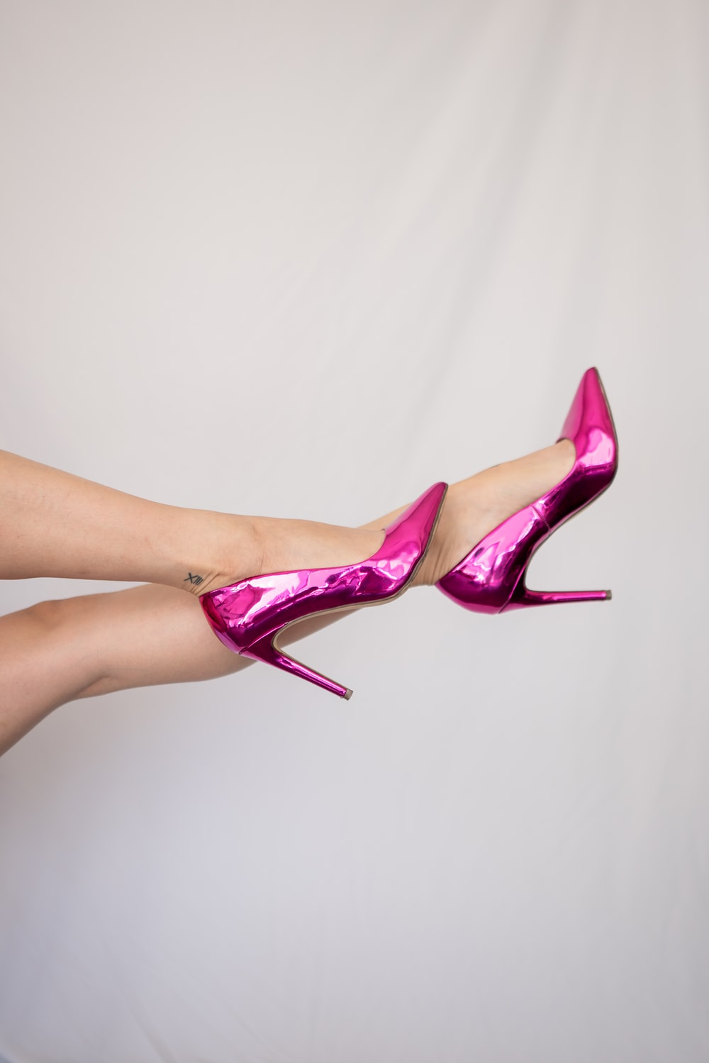 woman in pink patent leather stilettos