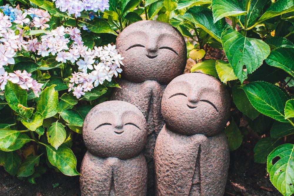 three human figurines