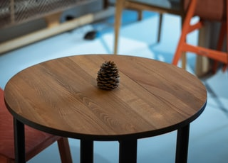 brown pine cone on table