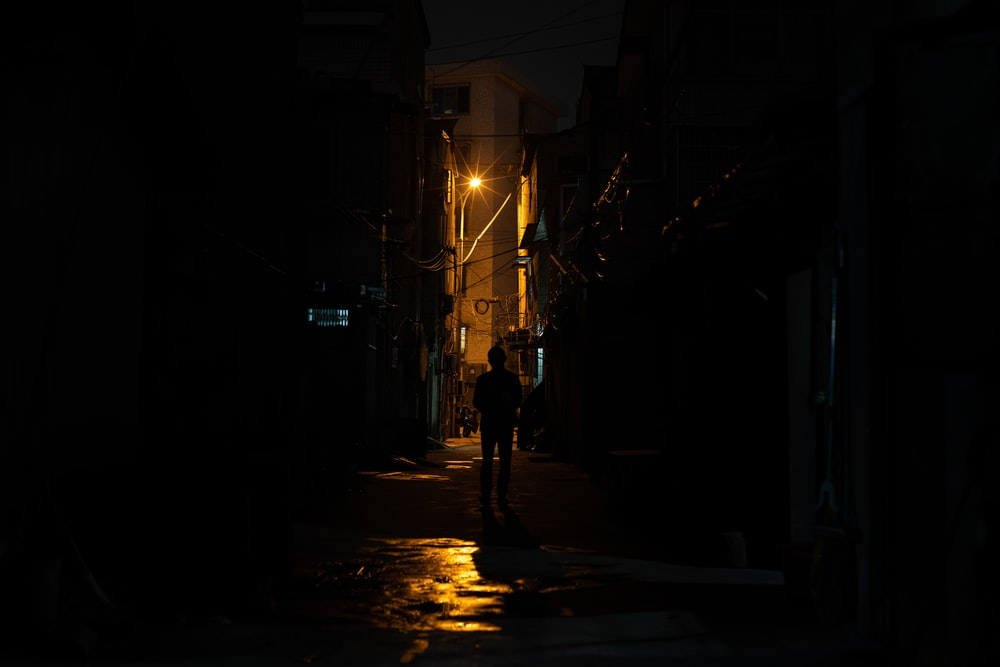 silhouette of person near buildings