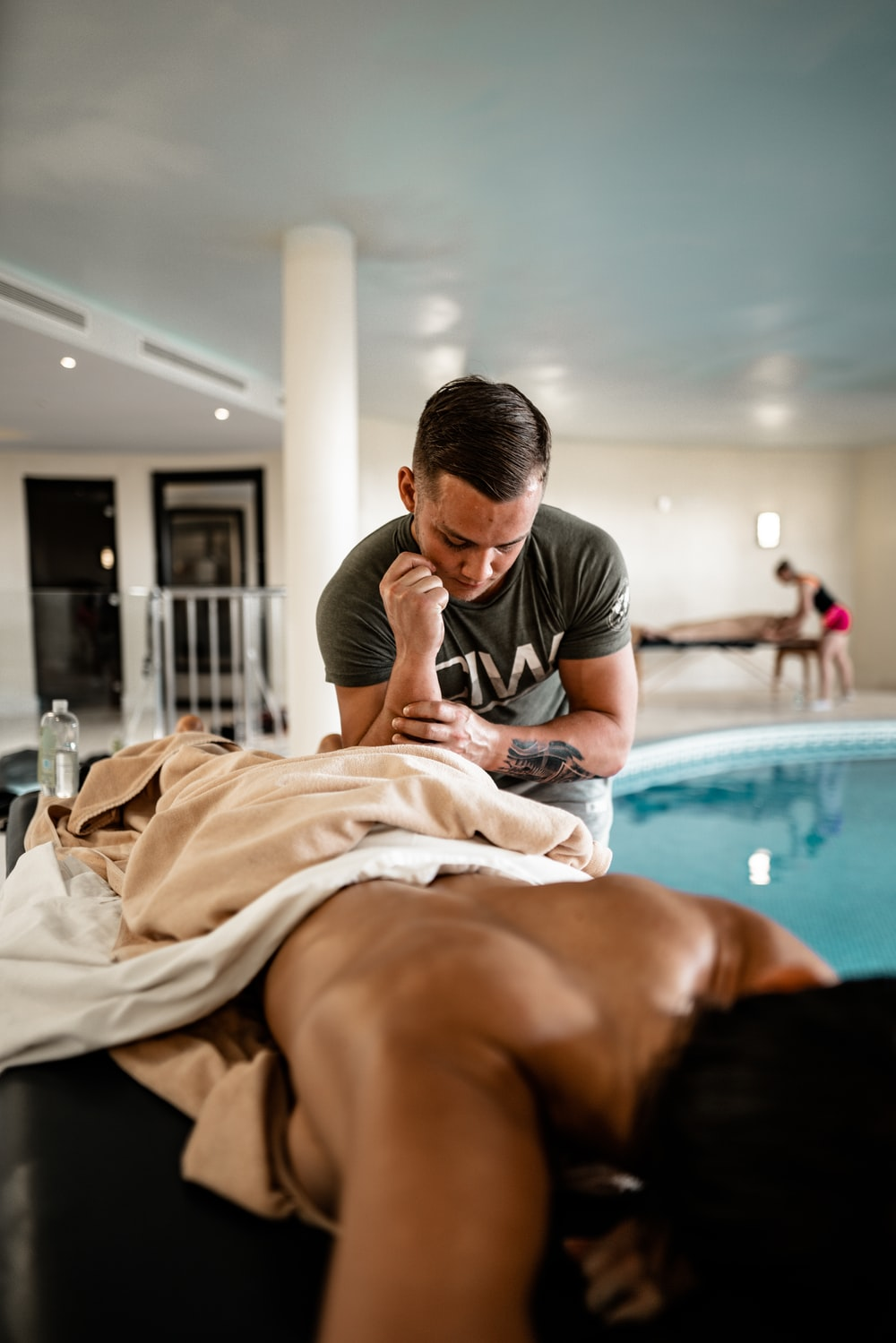 photography of man massaging a woman