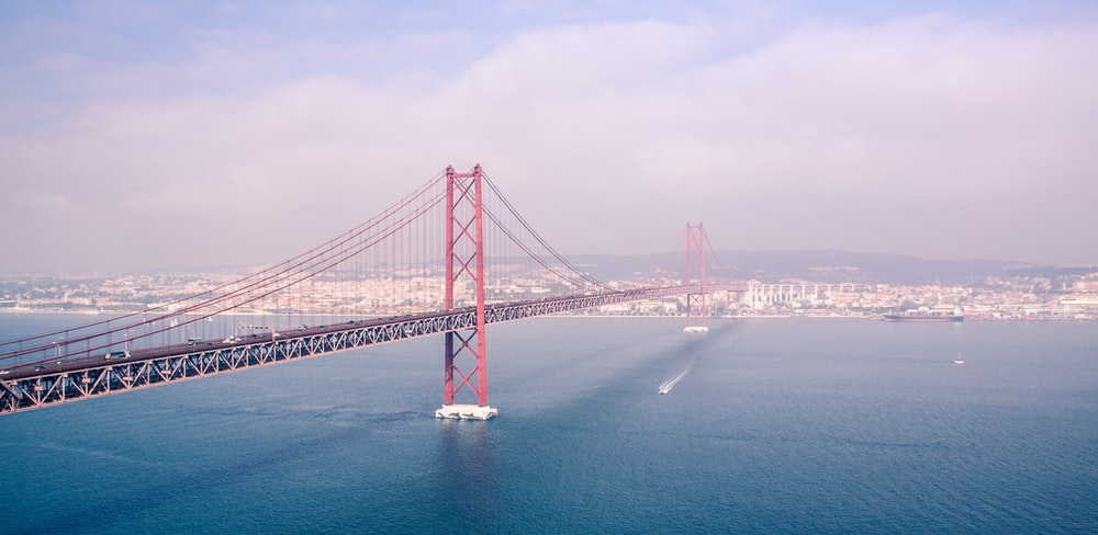 photography of red and gray bridge during daytime
