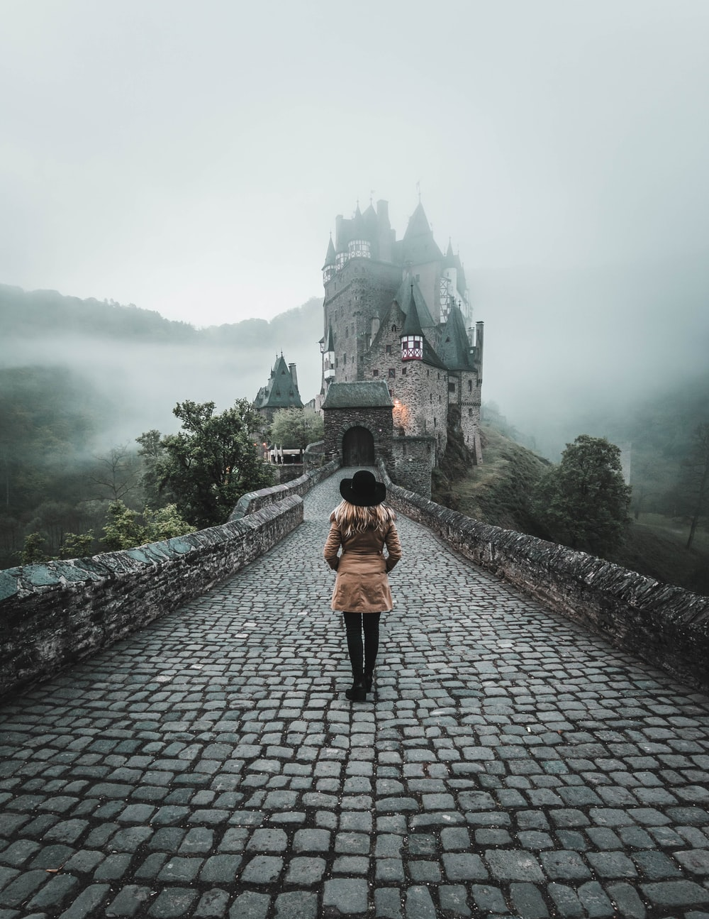 woman standing on concrete floor to castle