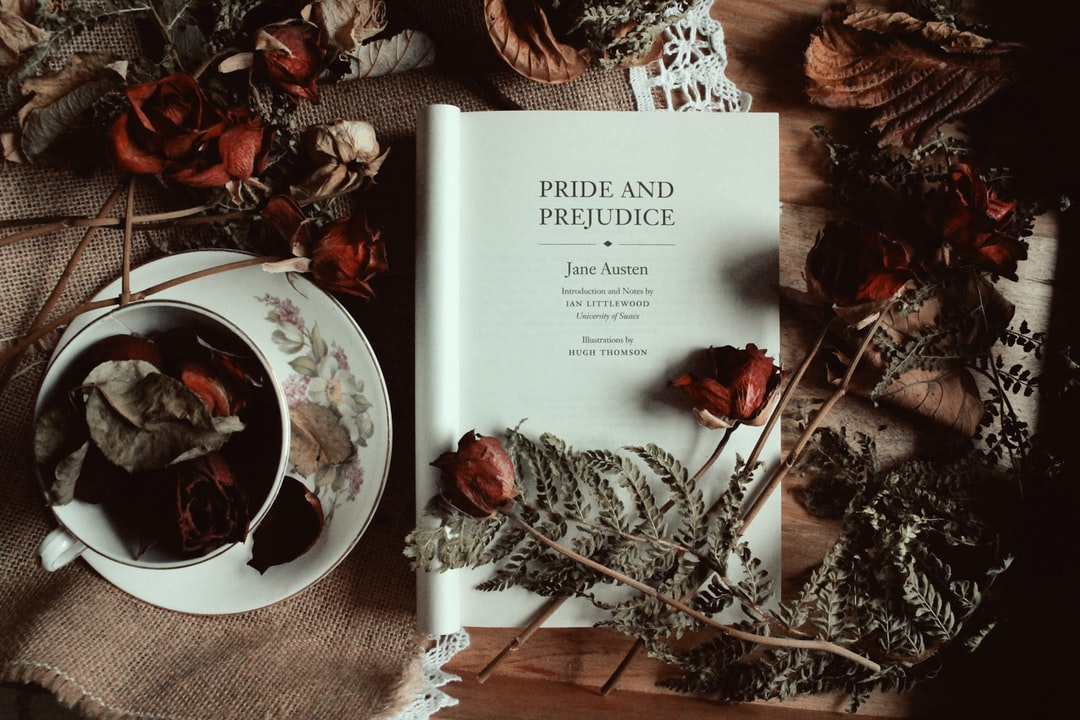 Pride and Prejudice by Jane Austen title page with dried Autumn leaves and roses and a teacup.