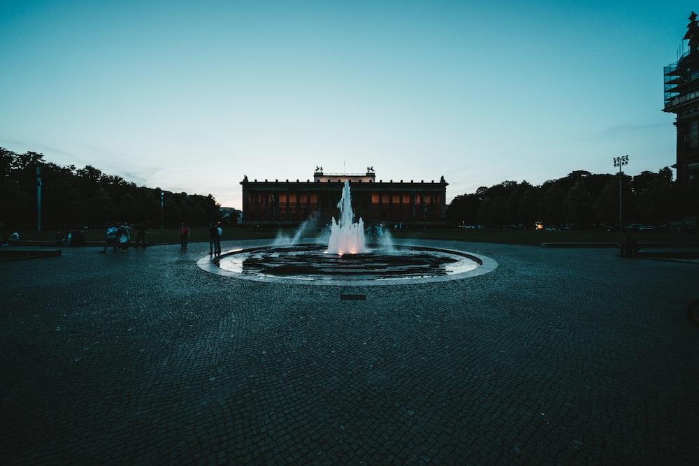 people walking beside fountain