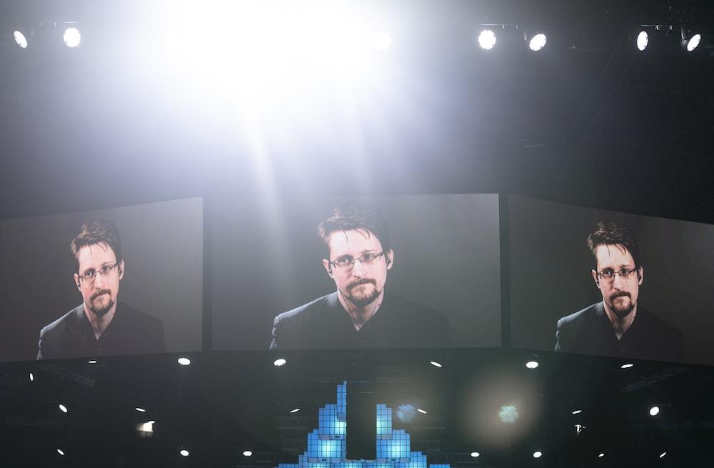 men's black suit on screen