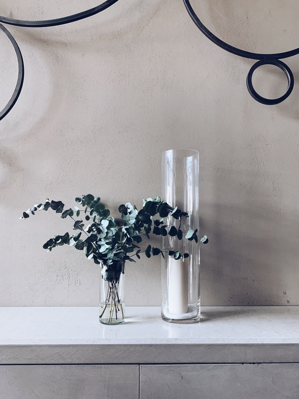 green plant in vase and glass holder