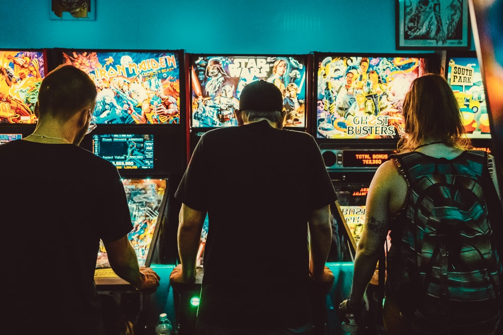 people playing arcade machines