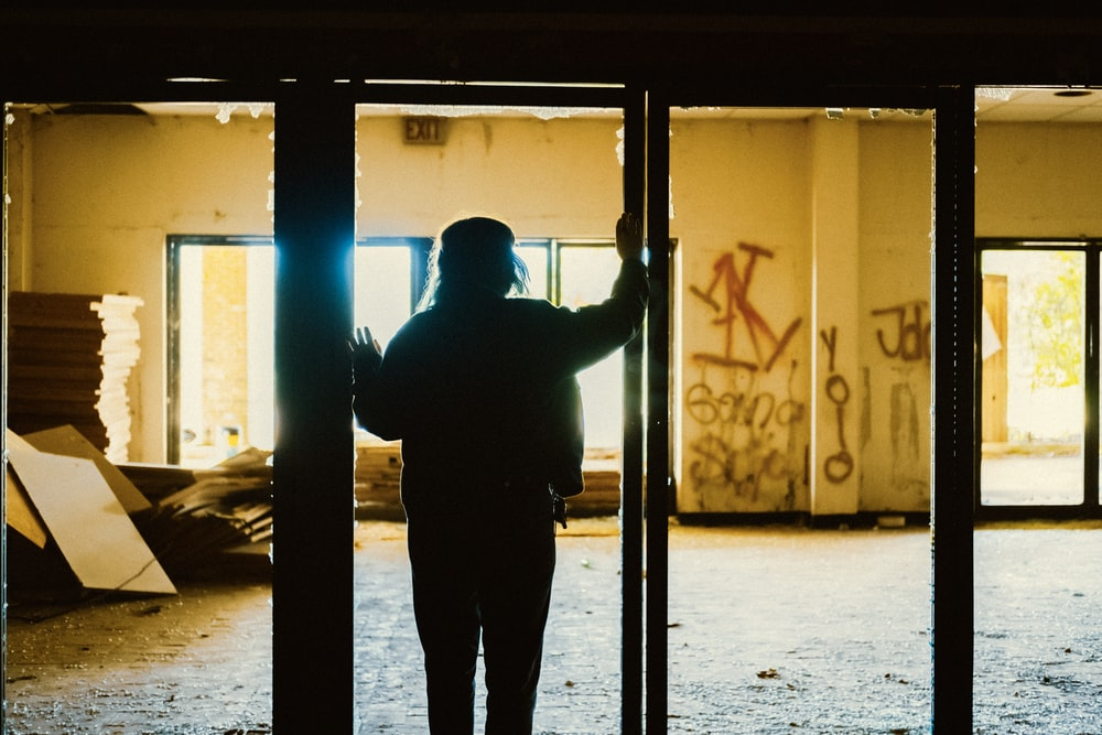 silhouette of person in empty room