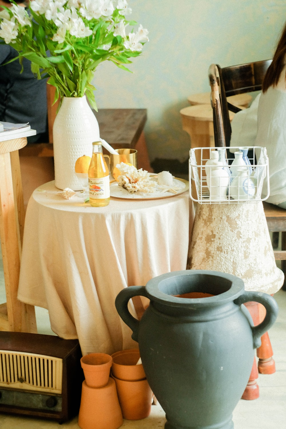 two gray vase beside table with tablecloth