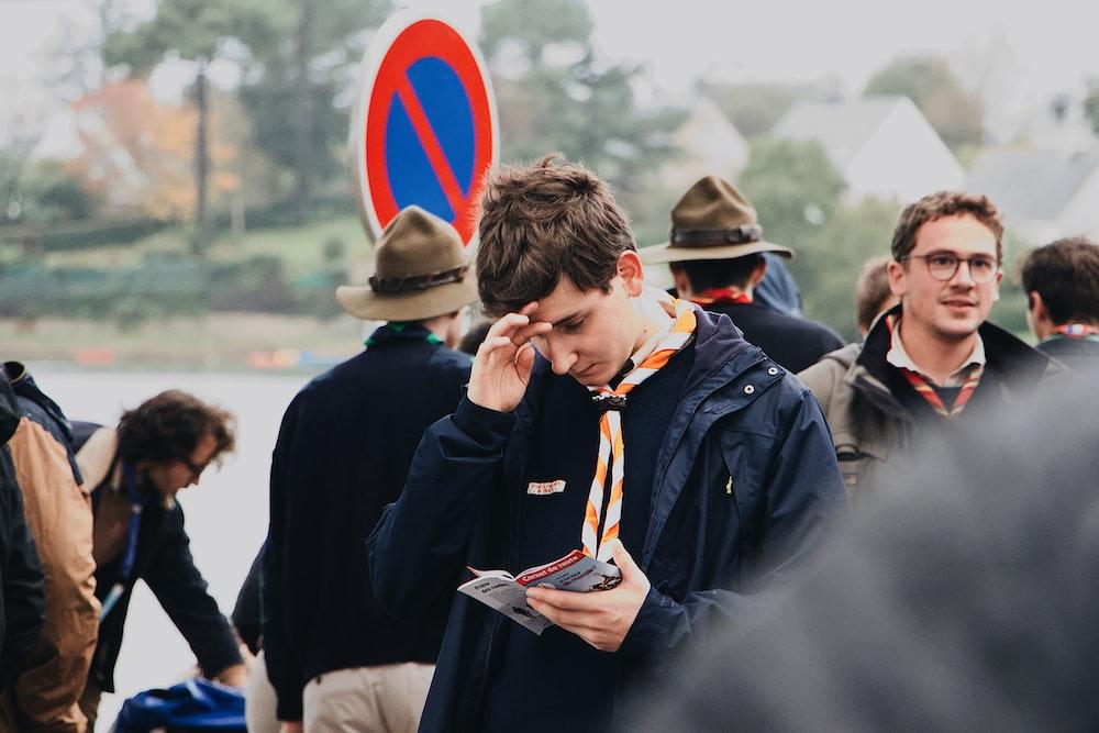 man looking at brochure