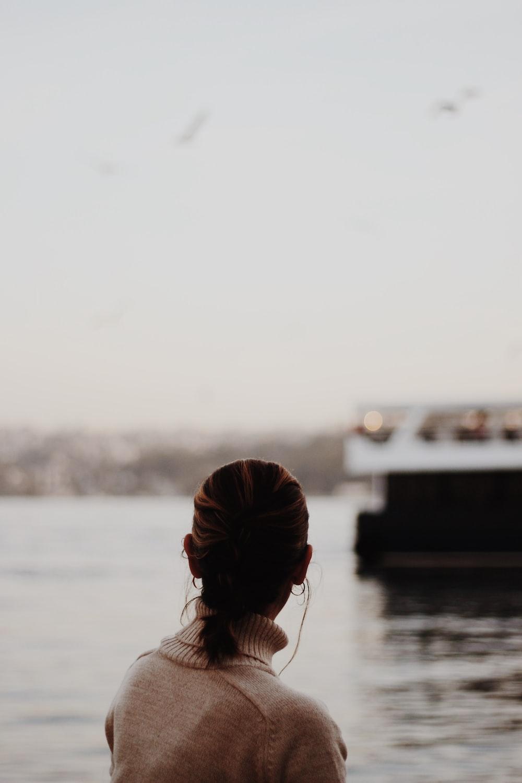 woman overlooking body of water
