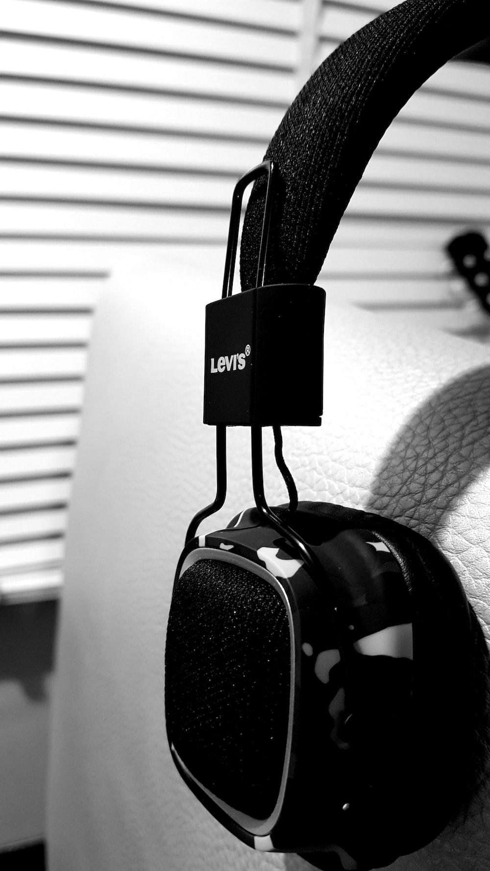 black headphones on gray sofa