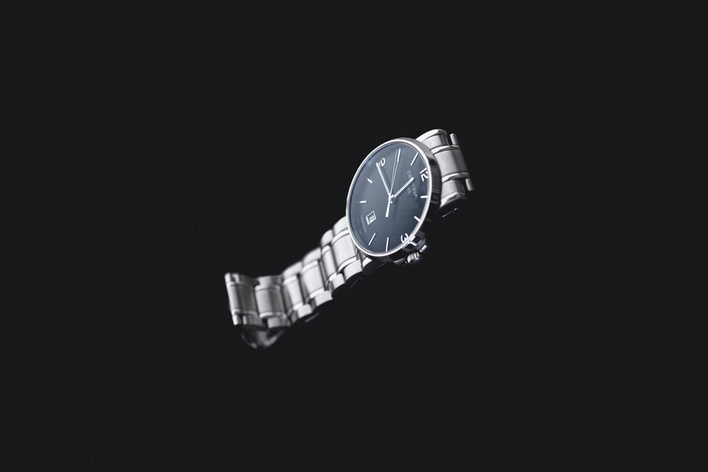 round silver-colored analog watch with link band