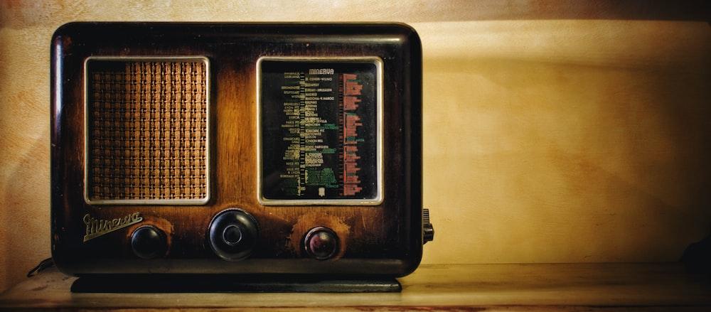 selective focus photography of brown transistor radio