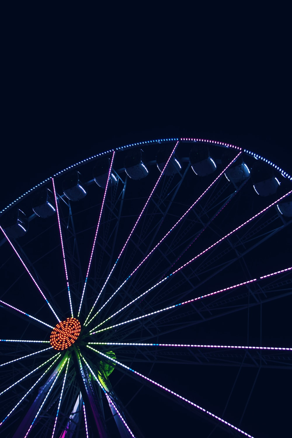 low-angle photography of Ferris wheel at night