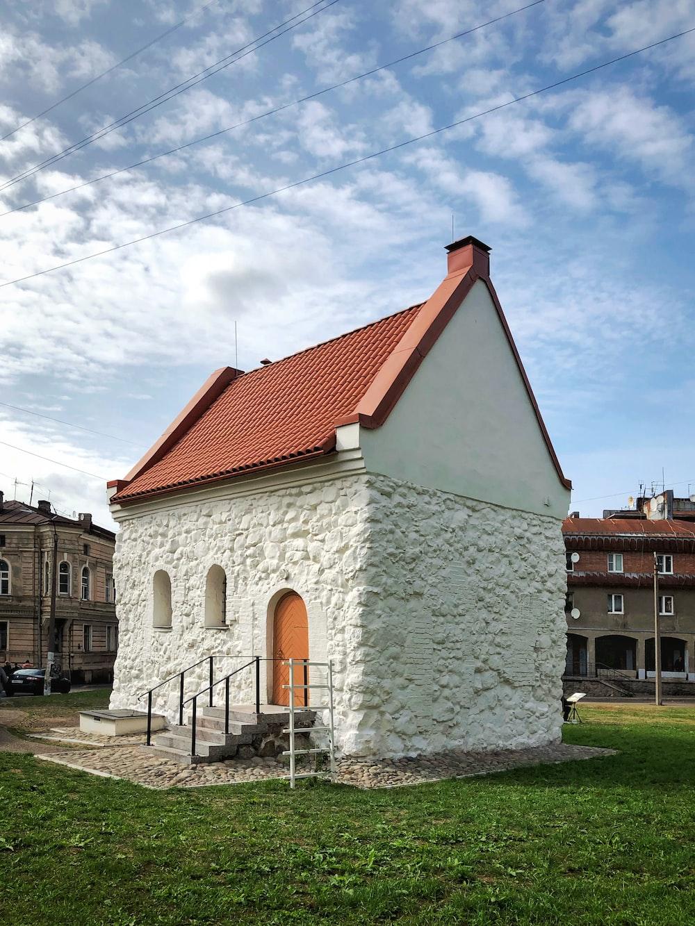 white concrete house during daytime