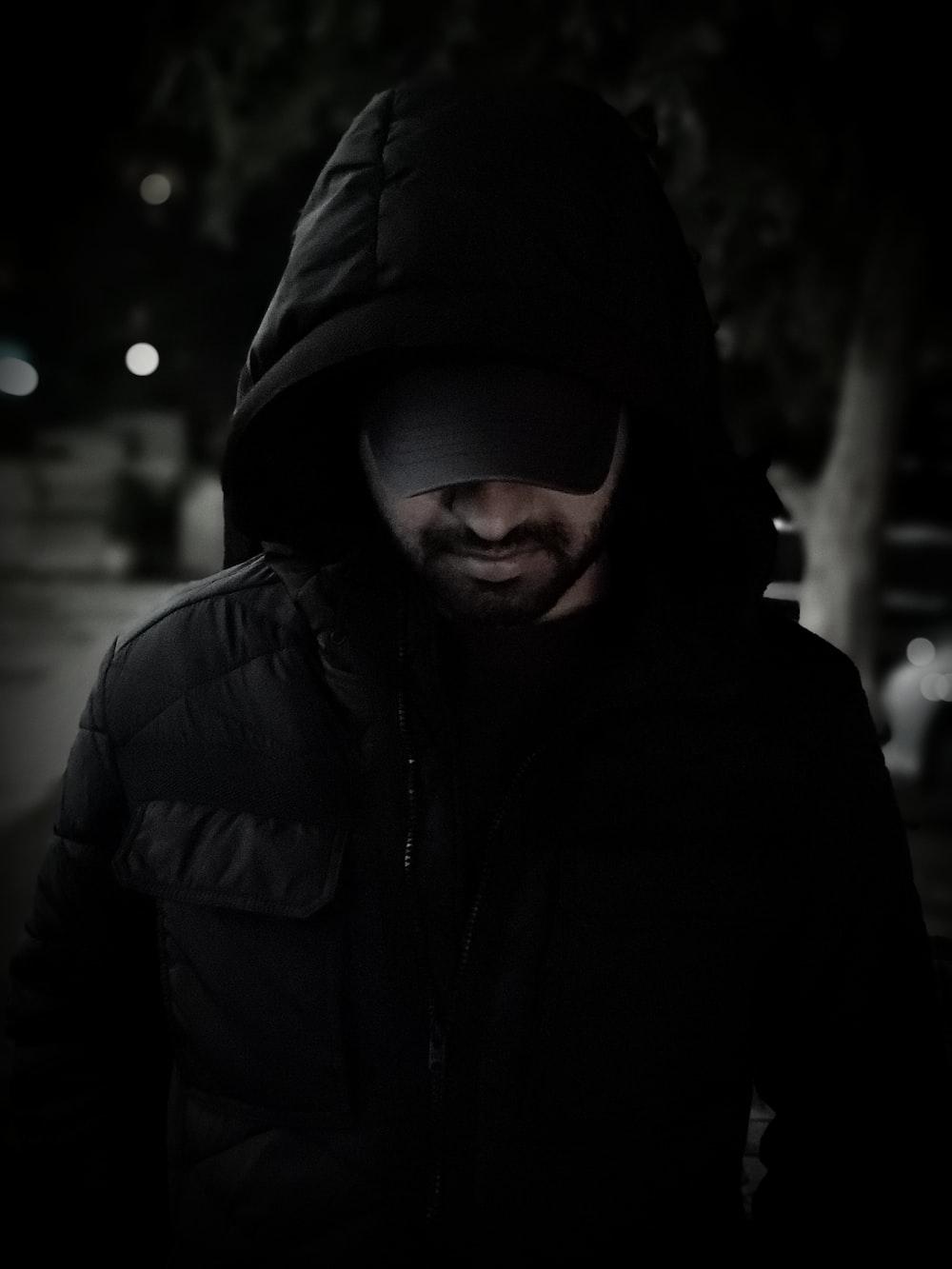 man wearing black hoodie