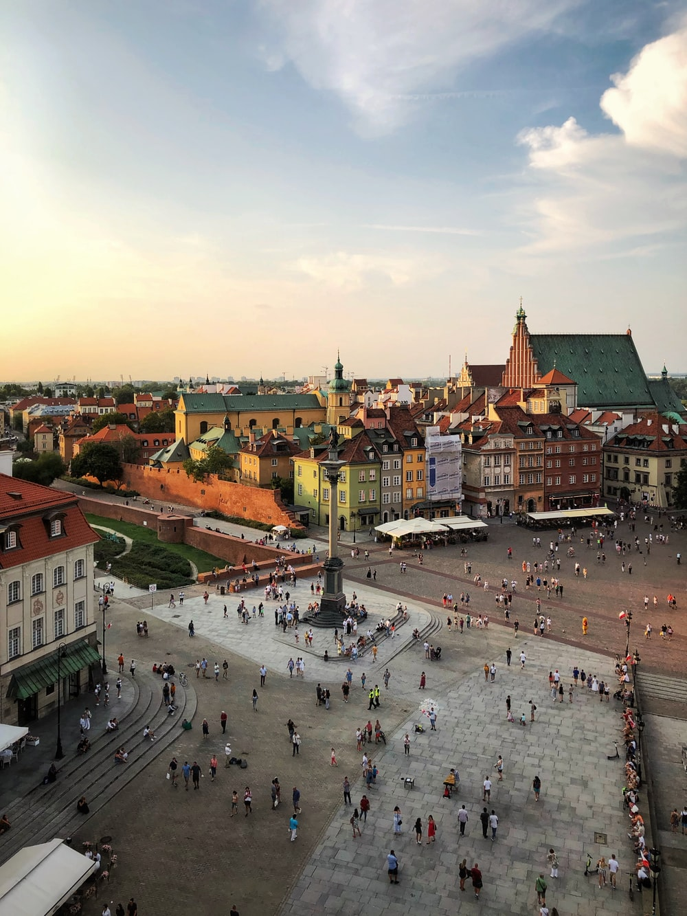 aerial photograph of people walking on town square