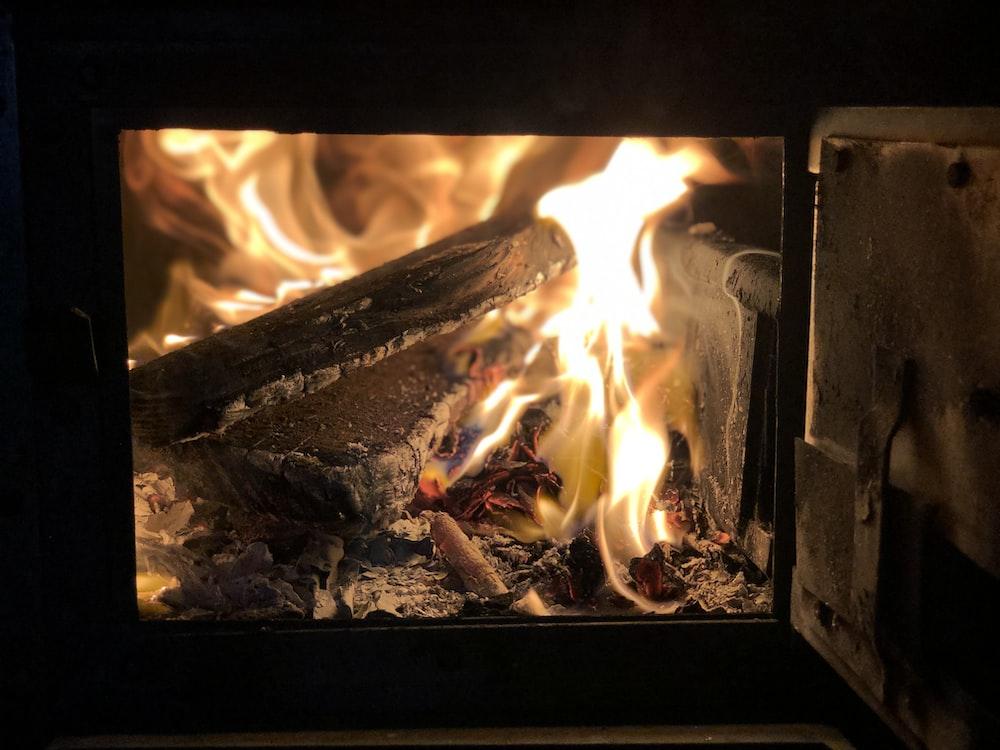burning firewood in wood burner