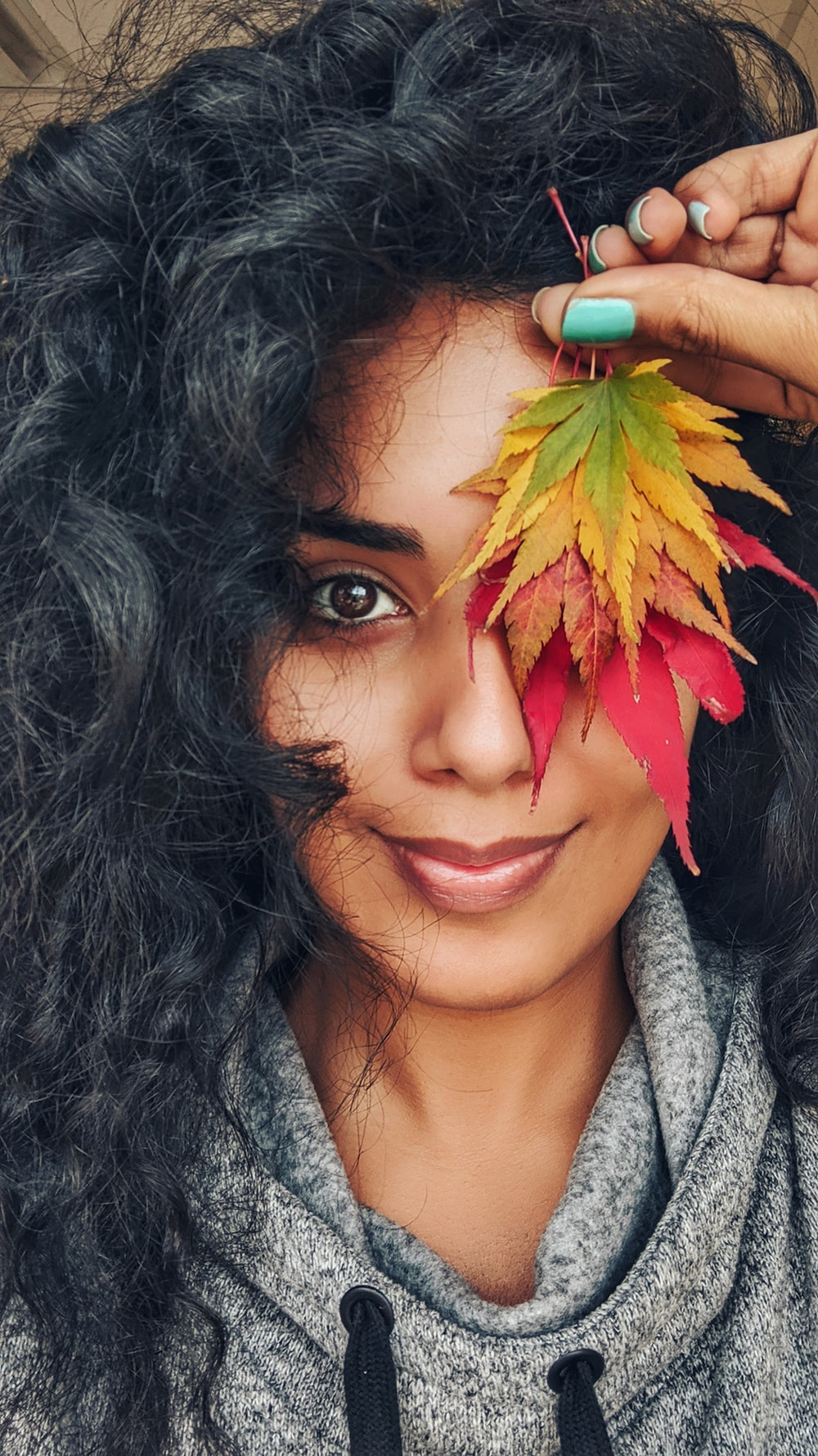 woman holding withered leaves