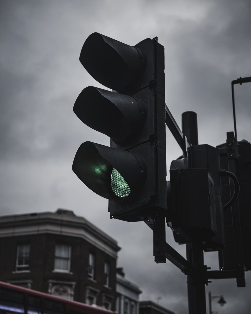black traffic light on green