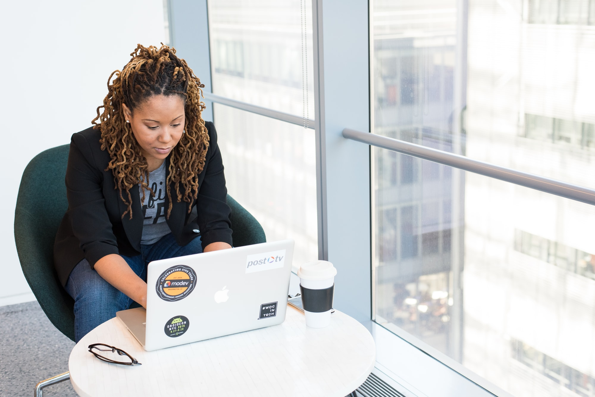 a black woman in front of a laptop