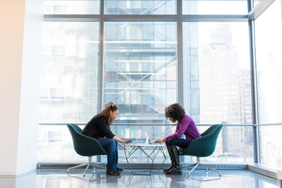 Two people discussing