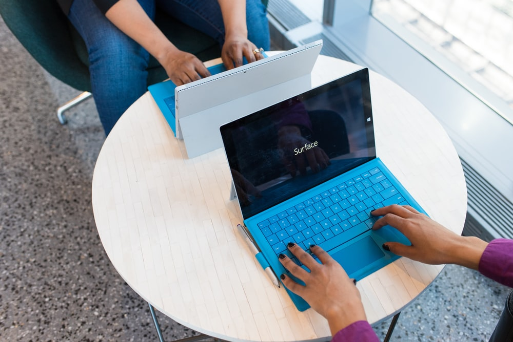 two person using Microsoft Surface