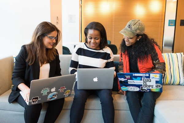 Diversity and inclusion. three women sitting on sofa with MacBook