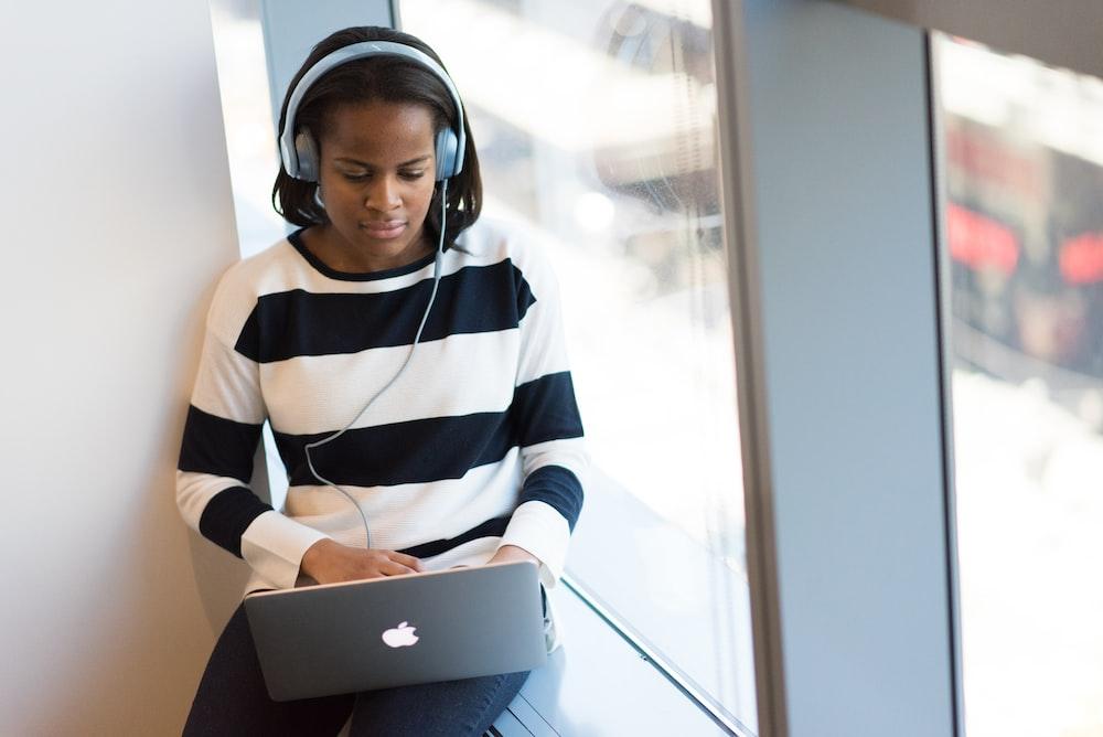 woman using MacBook Pro