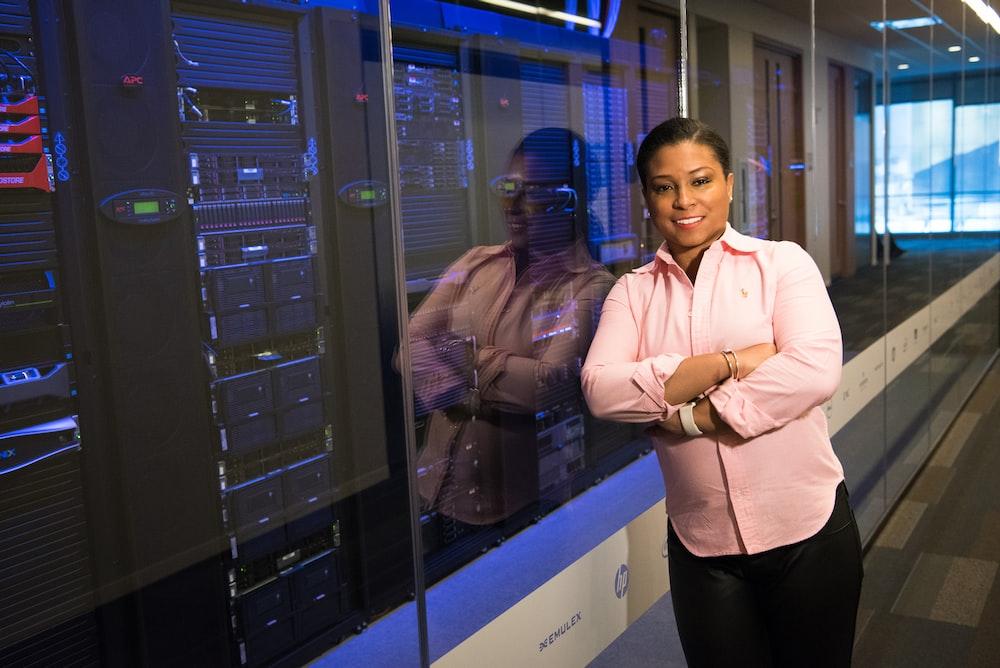 woman standing near servers