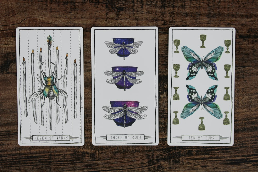 selective focus photography of three tarot cards