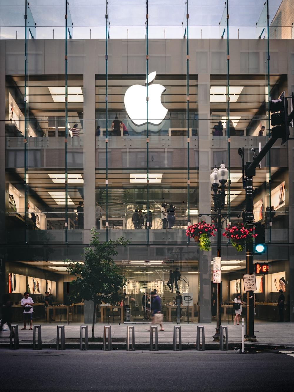 people walking beside Apple building during daytime