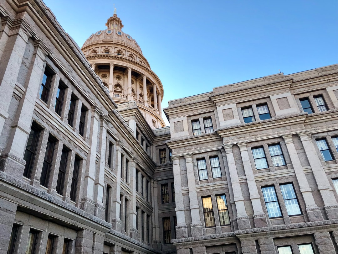 The Texas State Capitol set against a clear blue sky.