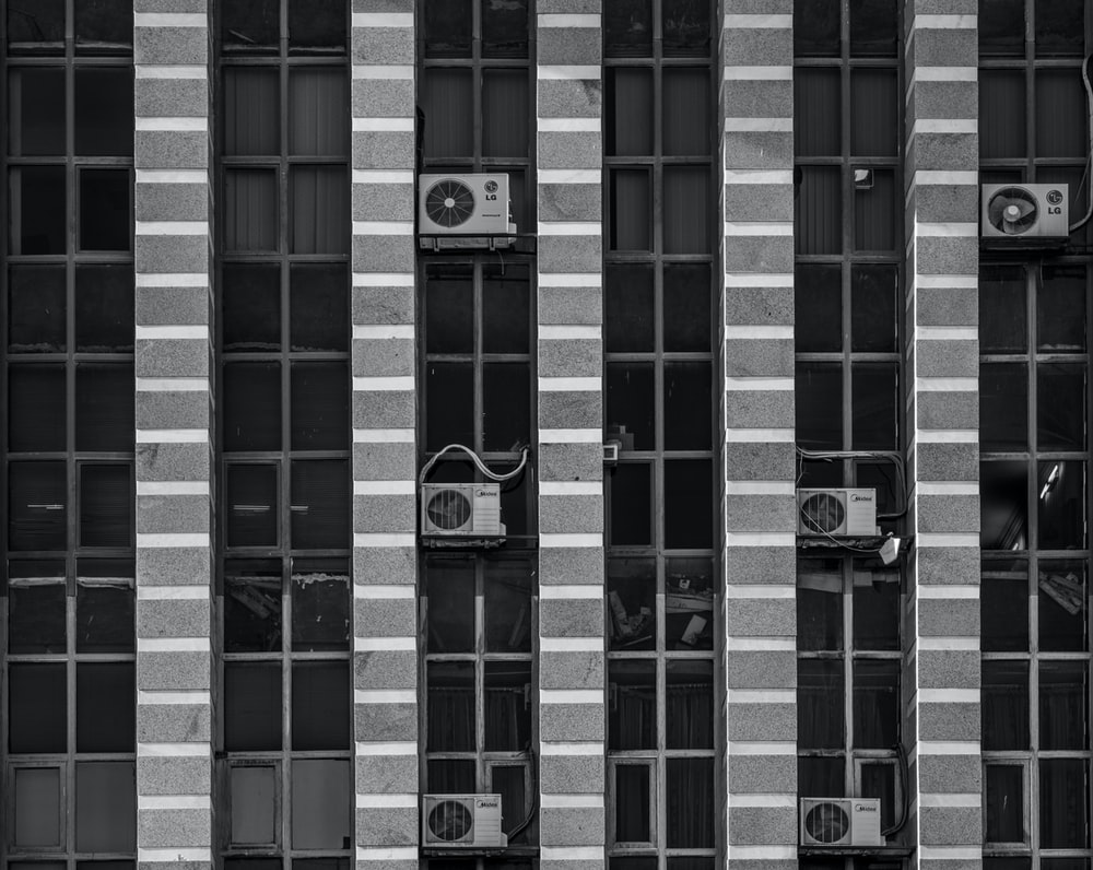 gray and black building with AC condenser unit during daytime