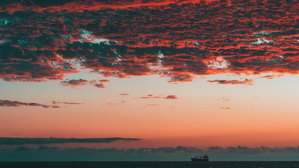 cargo ship sailing during golden hour