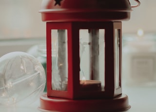 selective focus photography of red candle lantern
