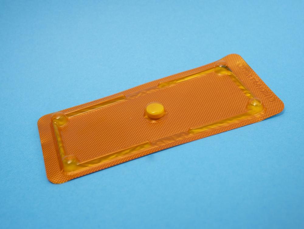 round orange medication pill