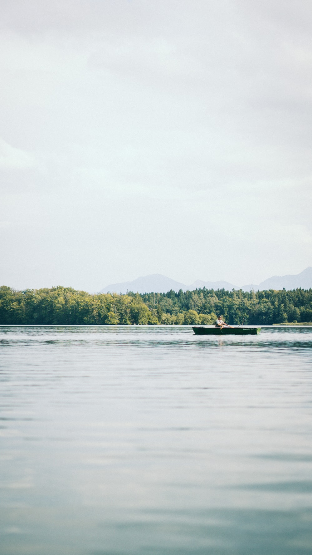 person riding canoe during daytime