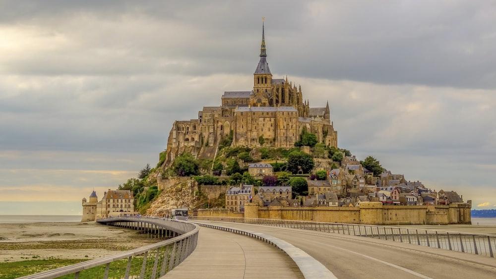 gold castle under grey sky