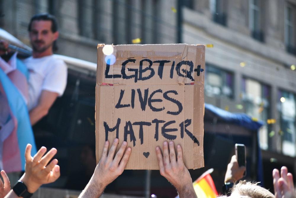 shallow focus photo of LGBTIQ+ Live Matter signage