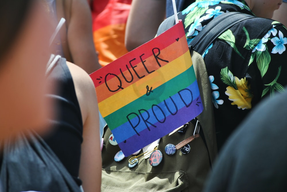 selective-focus of photography of Queer & Proud signage