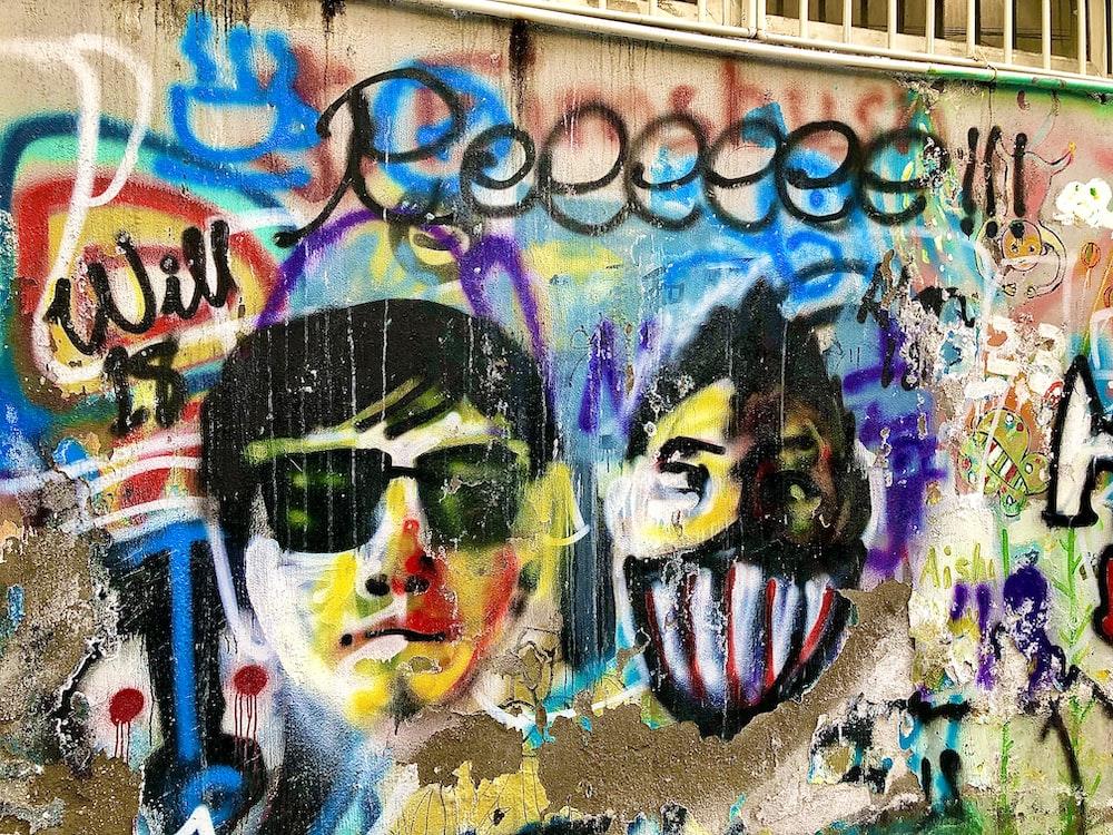 man wearing sunglasses graffiti